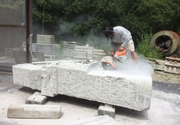 A man drilling granite