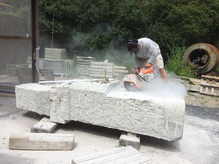 A man drilling granite